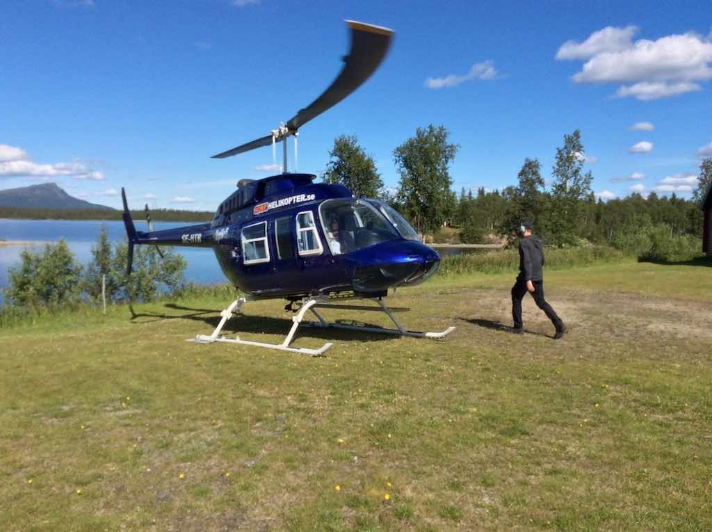 Saxnas, Sweden - Heli Ride Pilot walking back