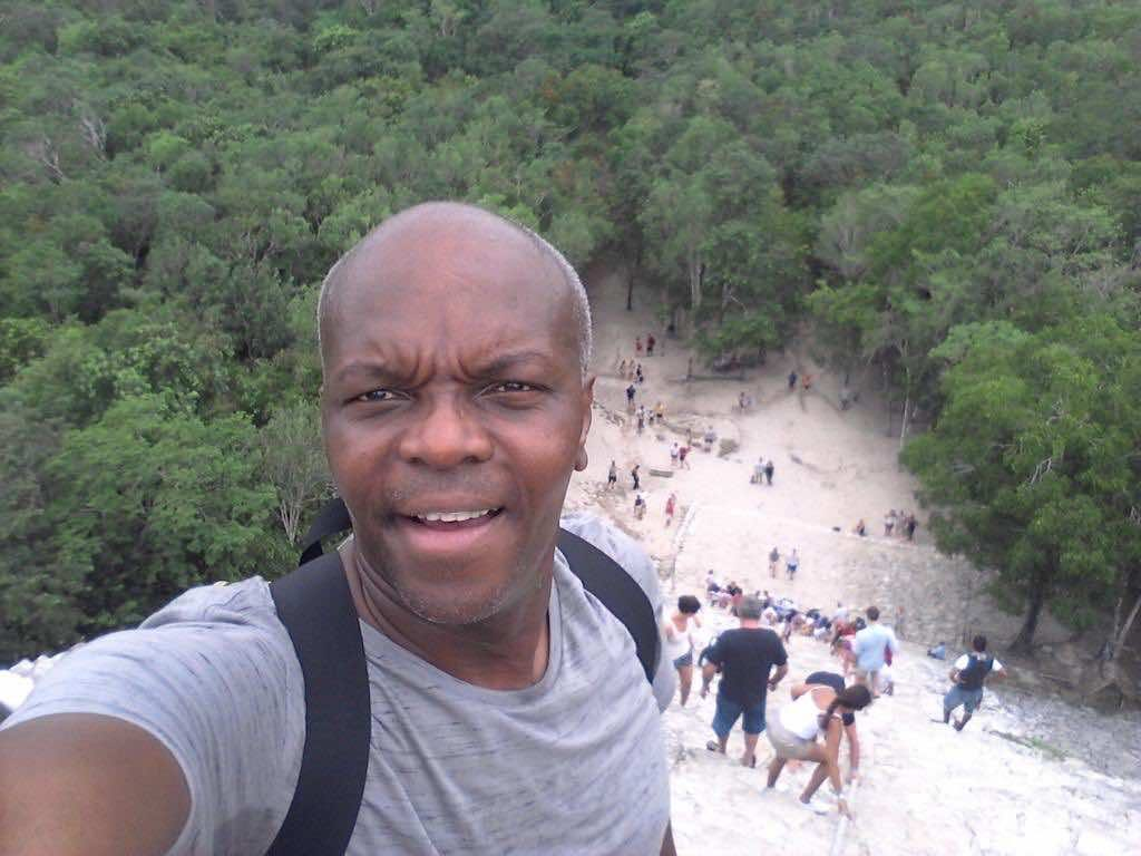 Coba, Mexico - Kerwin at the top of Nohuch Mul Coba