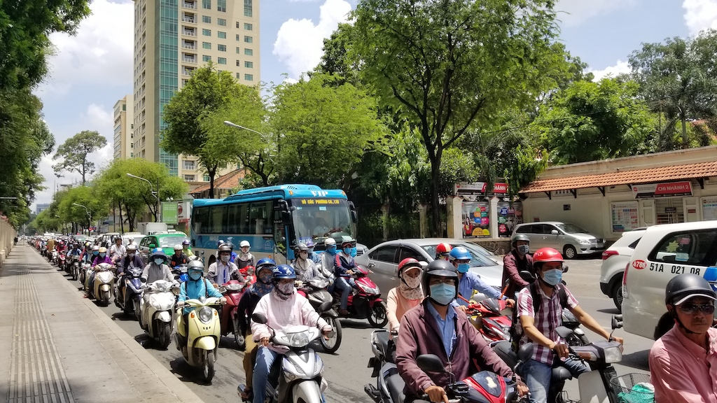 Ho Chi Minh City, Vietnam - People on Motorbikes