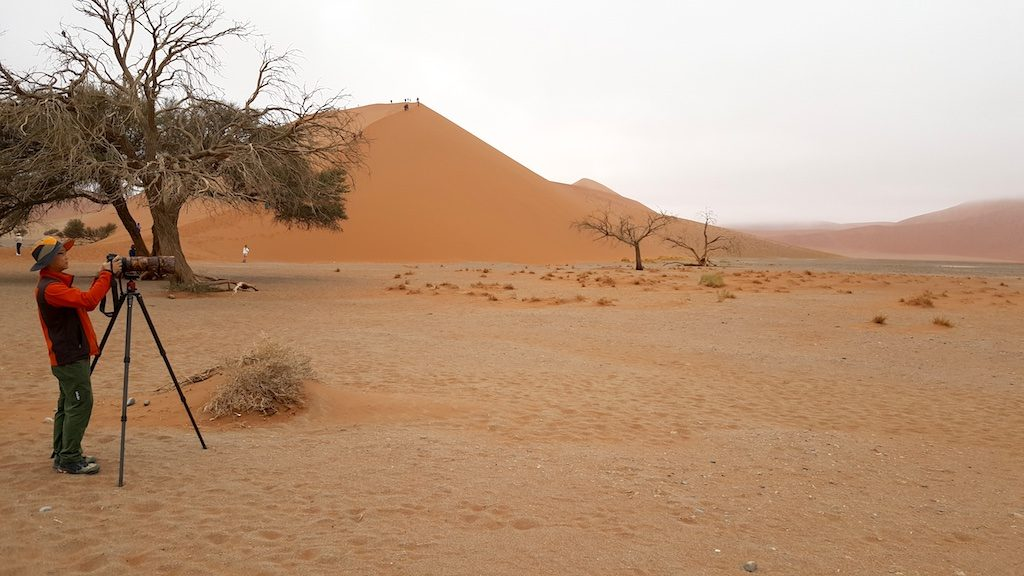 Dune 45, Sossusvlei, Namibia - Tourist taking photo
