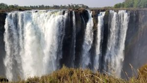Victoria Falls, Zimbabwe - Devil's Pool seen from the Zimbabwe side of the Falls. Devil's Pool is located on the Zambian side.
